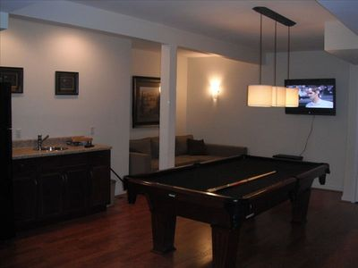 Play room with pool table, kitchenette, fridge, sleeping sofa, 42 inch TV