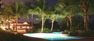 Night view of 1 of our private Villa pools ; ocean just to the right