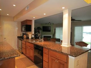 Moneta condo photo - Kitchen with great view of the water and seating at the counter-height bar