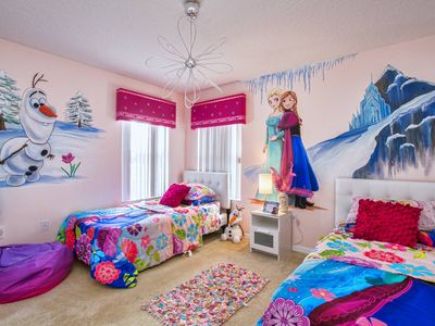 This Frozen-themed twin room creates a magical atmosphere for young girls.