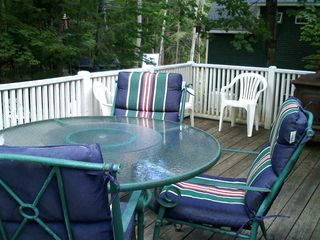 Moultonborough cottage photo - upper deck with grille and comfy chairs for out door dining as well as torches