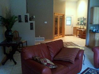 Living Area Looking to Main Hall, Den and Access to Rear Deck - Pentwater house vacation rental photo