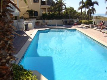 Pool with Large Deck Area, Plenty of Seating, BBQ Grill and Beach Access