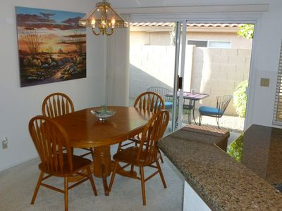 Dining Area offers seating for four, with access to side patio.