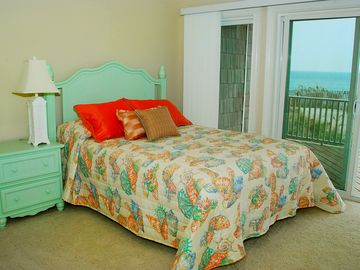 Oceanfront queen suite with private bathroom and private deck.