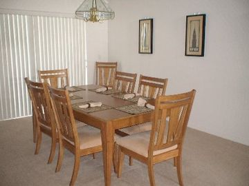 Large dining area - has view and doors out to the pool.