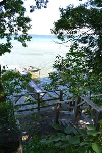 Cheboygan house rental - View of dock from top of stairs.