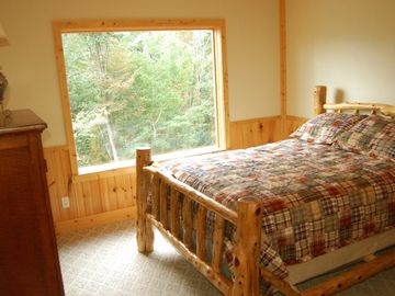 The second bedroom has a gorgeous queen bed and Grandfather views.