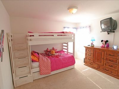 The girls room with 3 beds