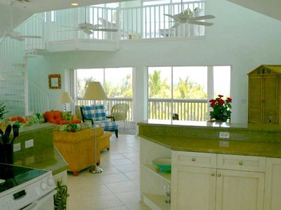 Kitchen/Family Room Opens onto a Screened Deck Overlooking the Gulf