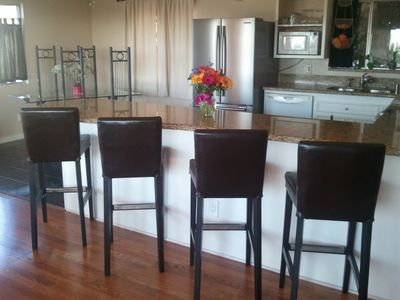 Gorgeous granite countertops and additional seating area for meals and visiting.