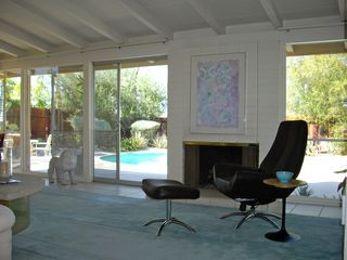 Rancho Mirage house photo - Living room with fireplace overlooking the pool.