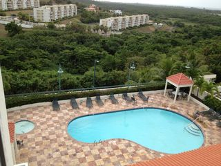 Rio Mar villa photo - Community pool & kids pool - view from unit