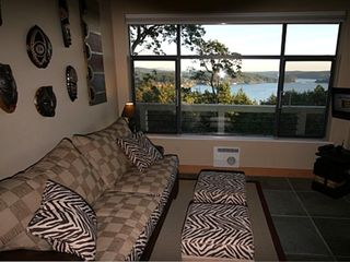 Guest House living room with expansive views of the sound Flatscreen TV and DVD