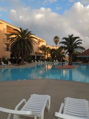 Galveston condo photo - What fun to sit by the Resort Pool and watch the puffy clouds roll in