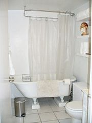 Soak in the 100 yr. old claw foot tub. - Harlem apartment vacation rental photo