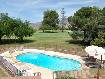 Springville house rental - Private fenced pool with plenty of lounging spots on a warm day.