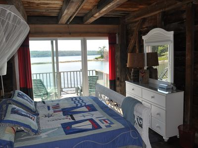 King bed with wide sliding doors to deck and VIEW south of Sheepscot River