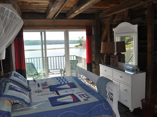 Westport Island cottage photo - King bed with wide sliding doors to deck and VIEW south of Sheepscot River