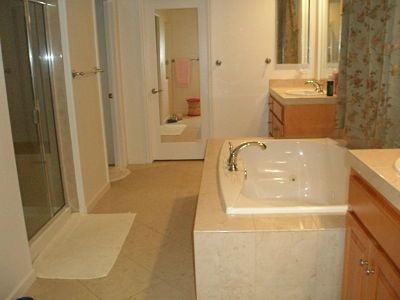 Upstairs: Master bathroom with jaccuzi tub, 2 sinks & seperate glass shower.