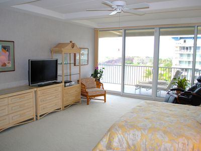 Master bedroom with lanai access and great view.