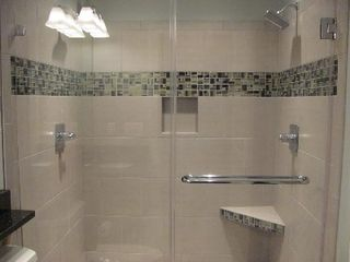 Clover house photo - Tiled bath with double showers