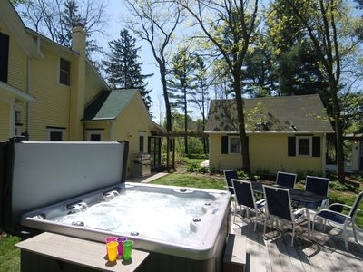 The outdoor hot tub, gas BBQ grill, under the shaded trees
