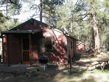 Flagstaff cabin rental - The Bunk House. A large picnic table, fire pit & chairs (unseen)