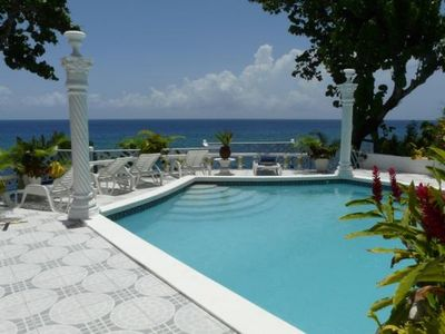 Ocho Rios castle rental - Waterfalls, swim up bench spa pool, and forever sea views at Castles on the Sea