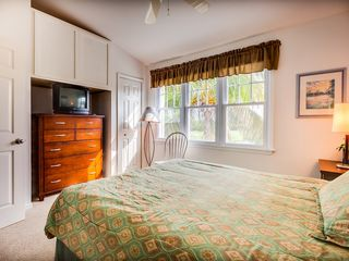 Key West house photo - Master suite has a queen bed and a TV.