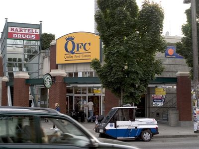 The QFC grocery store is directly across the street.