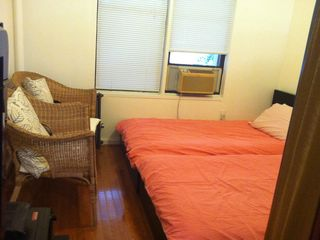 Midtown Manhattan property rental photo - two single beds in living area