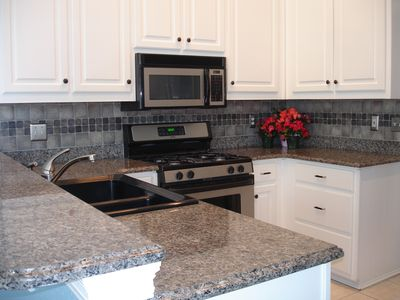 Granite counters with stainless steel appliances a