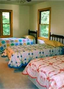 Large 2nd floor bedroom w/ 3 twin beds.