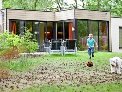 Holiday house in a park with a covered swimming pool close to Eindhoven
