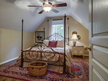 Upstairs bedroom with queen size bed - barn view