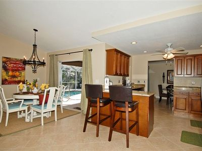 Breakfast nook, access to lanai, and kitchen.