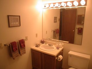 Pittsfield condo photo - Vanity is well lit and has large mirror.