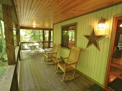 Front wrap around porch with lots of rocking chairs & outside dining too