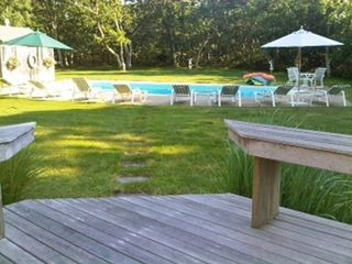 Chilmark house photo - View from deck with pool and outdoor furniture