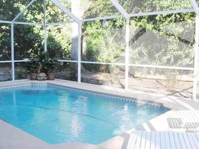 Private Heated Screened Pool, Lanai Area w/ Patio Seating, Outdoor Kitchen