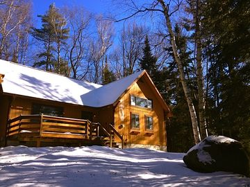 Saranac Lake lodge rental - A bright sunshiny winter day at Bear'n Lodge
