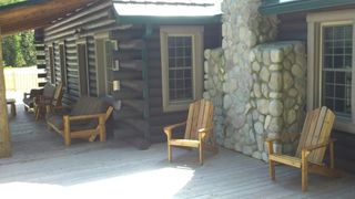 Grayling lodge photo - Eastside porch with lounge chairs.