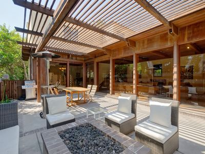 Patio with gas BBQ and fire pit.