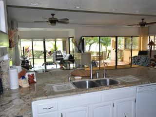View from Kitchen to Dining Room & Living Room area - Kailua Kona condo vacation rental photo