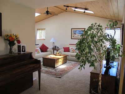 Family room, high ceilings, lots of light, access to back yard and deck