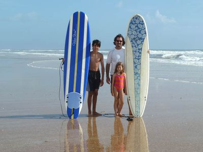 Learn to surf on our light weight boards for a small fee - easy and so much fun!
