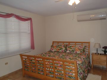 Master Bedroom - King Size Bed - Air conditioning and ceiling fan.
