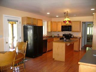 Lake Cle Elum house photo - Spacious dining room and kitchen with island.