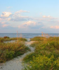 Sandy path at the end of the boardwalk to the beach. Natural, beautiful !